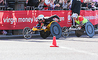 Men's wheelchair winner Marcel Hug of Switzerland and runner-up David Weir pass Buckingham Palace and the Victoria Memorial as they approach the finish of the Virgin Money London Marathon 2014<br /> on Sunday 13 April 2014<br /> Photo: Dave Shopland/Virgin Money London Marathon<br /> media@london-marathon.co.uk