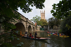 © licensed to London News Pictures. 01/05/2011. Oxford, UK.  Punters and kayakers enjoy May Day celebrations in  Oxford, Oxfordshire today (01/05/02011) underneath Magdalen Bridge. Revelers where prevented from jumping from the bridge which is tradition. Please see special instructions for usage rates. Photo credit should read Ben Cawthra/LNP