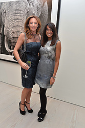 Left to right, SAMANTHA WICKENS and JACKIE ST.CLAIR at a private view of photographs by wildlife photographer David Yarrow included in his book 'Encounter' held at The Saatchi Gallery, Duke of York's HQ, King's Road, London on 13th November 2013.
