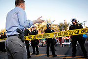 "An armed man addresses police during the ""Freedom of Speech Rally Round II"" across the street from the Islamic Community Center in Phoenix, Arizona May 29, 2015.  Arizona police stepped up security near a mosque on Friday ahead of a planned anti-Islam demonstration featuring displays of cartoons of the Prophet Mohammad, weeks after a similar contest in Texas came under attack from two gunmen.  REUTERS/Nancy Wiechec"