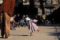 a child's first steps in a Paris park