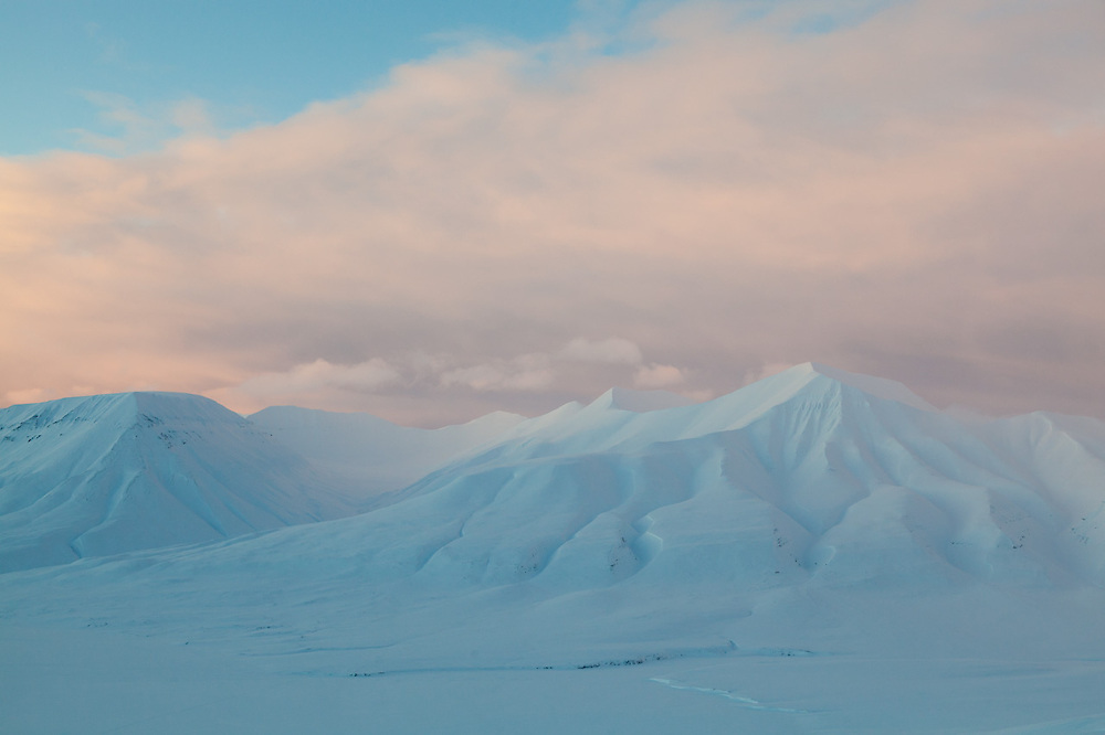 Sunset light on Helvetiafjellet (right) and Bassen, Svalbard.