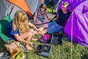 Making tea. The 2015 Glastonbury Festival, Worthy Farm, Glastonbury.