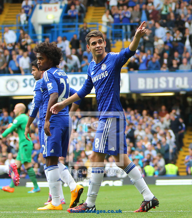 Oscar of Chelsea celebrates opening the scoring against Aston Villa during the Barclays Premier League match at Stamford Bridge, London<br /> Picture by John Rainford/Focus Images Ltd +44 7506 538356<br /> 27/09/2014