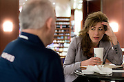 UConn President Susan Herbst meets with the Board of Trustees Chairman Larry McHugh at the Hyatt Regency in Dallas, Texas before watching her school compete in the NCAA Final Four on April 5, 2014. (Cooper Neill / for The New York Times)
