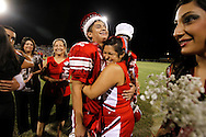 Gus Garcia gets a hug from a cheerleader after the football senior was named the homecoming king Sept. 30, 2011 during halftime in Premont.