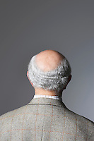 Senior Man in studio head and shoulders back view