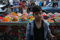 June 4, 2017 - Gaza, gaza strip, Palestine - A Palestinian boy sells sweets with his father at a market in the old city during the Muslim holy month of Ramadan, in Gaza City, Gaza Strip, 04 June 2017.  Muslims start fasting before sunrise at down and break their fasting after sunset. Muslims around the world celebrate the holy month with prayers and reading from the Quran as they fast from eating, drinking, smoking and sexual relations from dawn till dusk. (Credit Image: © Majdi Fathi/NurPhoto via ZUMA Press)