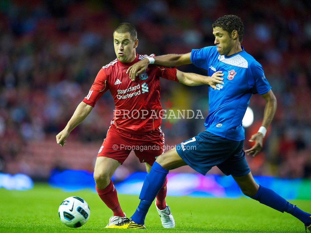 LIVERPOOL, ENGLAND - Thursday, August 5, 2010: Liverpool's Joe Cole in action against FK Rabotnicki's Fernando Lopes during the UEFA Europa League 3rd Qualifying Round 2nd Leg match at Anfield. (Pic by: David Rawcliffe/Propaganda)