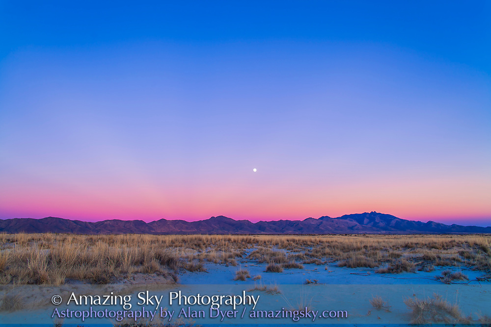 Sunset twilight colours and the waxing gibbous Moon over the Chiricahua Mountains in southeast Arizona, south of Willcox. Taken December 15, 2013 on Highway 186. Taken with the 24mm lens and Canon 5D MkII.