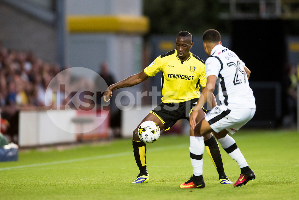 Lucas Akins of Burton Albion looks to get a round Marcus Olsson of Derby County during the EFL Sky Bet Championship match between Burton Albion and Derby County at the Pirelli Stadium, Burton upon Trent, England on 26 August 2016. Photo by Brandon Griffiths.