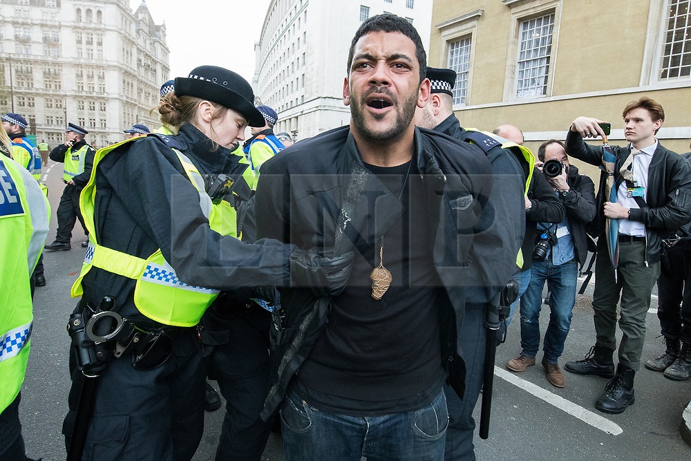 © Licensed to London News Pictures . 01/04/2017 . London , UK . Anti Fascist protesters clash with police on Whitehall . The EDL and Britain First both hold demonstrations in London , opposed by anti-fascist groups , including Unite Against Fascism . Photo credit : Joel Goodman/LNP