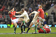Ugo Monye (England) forces his way through Stephen Jones (Wales) during the RBS 6 Nations Championship match between England and Wales at Twickenham Stadium on February 6, 2010 in London, England.