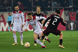 December 13, 2018 - Piraeus, Attiki, Greece - Leonardo Koutris (no 23) of Olympiacos, avoids Davide Calabria (no 2) of Milan. (Credit Image: © Dimitrios Karvountzis/Pacific Press via ZUMA Wire)