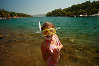 ten year old snorkeling on Hvar Island, Croatia-- photograph by Owen Franken..