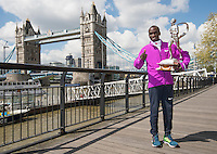 Virgin Money London Marathon 2015<br /> <br /> Winners Photocall<br /> <br /> Left to Right<br /> Eliud Kipchoge Kenya Mens winner<br /> <br /> Posing with the Sporting Life Marathon Trophy<br /> <br /> Photo: Bob Martin for Virgin Money London Marathon<br /> <br /> This photograph is supplied free to use by London Marathon/Virgin Money.