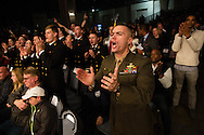 Marine Capt. Charles Pollution, right, cheers with Navy cadets during the Army-Navy Boxing Classic at the Pennsylvania Convention Center on Friday night before the long-time rivalry football game. The bouts featured boxers from both academy's boxing clubs. Army was the overall winner.