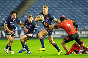 Darcy Graham (#14) of Edinburgh Rugby evades a tackle from Cyril-John Velleman (#6) of Isuzu Southern Kings during the Guinness Pro 14 2018_19 rugby match between Edinburgh Rugby and Isuzu Southern Kings at the BT Murrayfield Stadium, Edinburgh, Scotland on 5 January 2019.