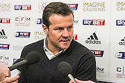 Swindon Town manager, Mark Cooper press conference during the Sky Bet League 1 match between Swindon Town and Crawley Town at the County Ground, Swindon, England on 21 February 2015. Photo by Shane Healey.