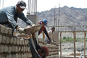 India, Karu Ladakh region state of Jammu and Kashmir, male and female construction workers