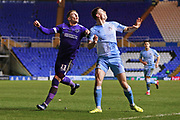 Portsmouth midfielder Ronan Curtis and Coventry City defender Michael Rose in action during the EFL Sky Bet League 1 match between Coventry City and Portsmouth at the Trillion Trophy Stadium, Birmingham, England on 11 February 2020.