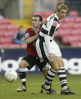 Photo: Aidan Ellis.<br /> Darlington v Swansea City. The FA Cup. 02/12/2006.<br /> Swansea's Leon Britton looks to go past Darlington's Patrick Collins