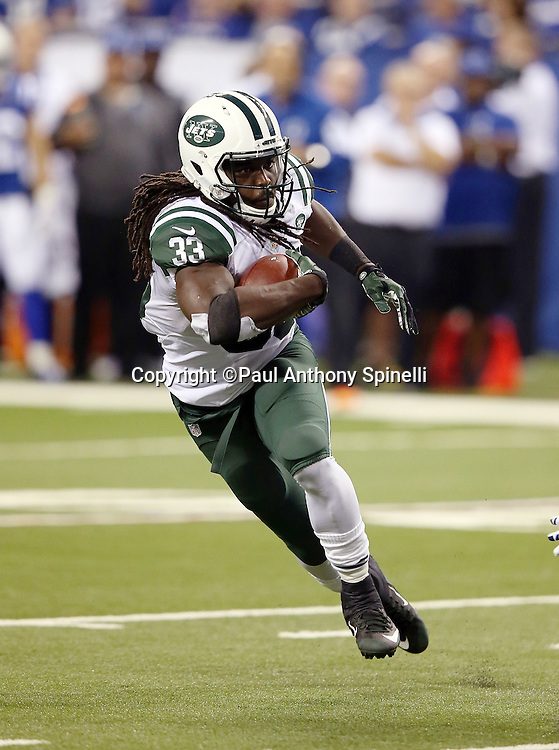 New York Jets running back Chris Ivory (33) makes a cut as he runs the ball in the first quarter during the 2015 NFL week 2 regular season football game against the Indianapolis Colts on Monday, Sept. 21, 2015 in Indianapolis. The Jets won the game 20-7. (©Paul Anthony Spinelli)