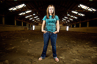 Felicia Pollos stands in the arena at Red Top Stables in Post Falls, Idaho on Friday, Aug. 19, 2011 while I test my lights for an assignment.