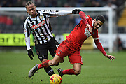 Notts County midfielder Curtis Thompson brings down Leyton Orient midfielder Jobi McAnuff during the Sky Bet League 2 match between Notts County and Leyton Orient at Meadow Lane, Nottingham, England on 20 February 2016. Photo by Jon Hobley.