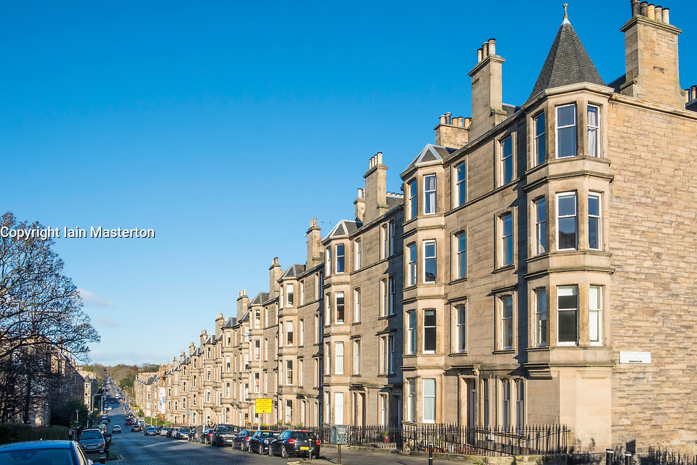 View of row of sandstone terraced apartments (tenements) on Comely Bank Avenue in Edinburgh, Scotland, United Kingdom