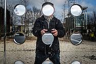 Nederland,  Rotterdam, 2 febr 2014<br /> In het museumkwartier in Rotterdam staat een spiegelende wand met gaten er in. Selfie van de fotograaf zonder zijn gezicht.<br /> Foto: Michiel Wijnbergh