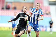 Wigan Athletic defender Dan Burn (33) and Brighton & Hove Albion centre forward Glenn Murray (17) compete for the ball during the EFL Sky Bet Championship match between Wigan Athletic and Brighton and Hove Albion at the DW Stadium, Wigan, England on 22 October 2016.