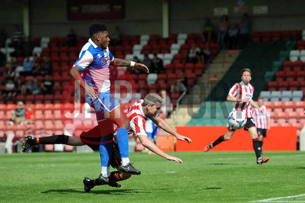 Ellis Harrison of Bristol Rovers challenges for the ball with Arron Downes of Cheltenham Town - Mandatory by-line: Dougie Allward/JMP - 25/07/2015 - SPORT - FOOTBALL - Cheltenham Town,England - Whaddon Road - Cheltenham Town v Bristol Rovers - Pre-Season Friendly
