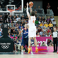 02 August 2012: Spain Pau Gasol takes a three points jumpshot over Great Britain Nate Reinking during 79-78 Team Spain victory over Team Great Britain, during the men's basketball preliminary, at the Basketball Arena, in London, Great Britain.