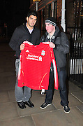 01.FEBRUARY.2011. LIVERPOOL<br /> <br /> NEW LIVERPOOL SIGNING LUIS SUAREZ POSED WITH A FAN HOLDING A LIVERPOOL SHIRT OUT AND ABOUT IN LIVERPOOL.<br /> <br /> BYLINE: EDBIMAGEARCHIVE.COM<br /> <br /> *THIS IMAGE IS STRICTLY FOR UK NEWSPAPERS AND MAGAZINES ONLY*<br /> *FOR WORLD WIDE SALES AND WEB USE PLEASE CONTACT EDBIMAGEARCHIVE - 0208 954 5968*