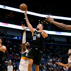 Feb 12, 2019; New Orleans, LA, USA; Orlando Magic guard Evan Fournier (10) shoots over New Orleans Pelicans guard E'Twaun Moore (55) during the second half at the Smoothie King Center. Mandatory Credit: Derick E. Hingle-USA TODAY Sports