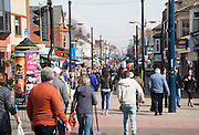 Crowds of people of a sunny day in a pedestrianised street, Middle Market Road, Great Yarmouth, Norfolk, England