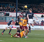24th February 2018, Dens Park, Dundee, Scotland; Scottish Premier League football, Dundee versus Motherwell; Mark O'Hara of Dundee rises above Ryan Bowman of Motherwell to win a header