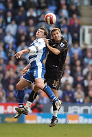 Photo: Leigh Quinnell.<br /> Reading v Portsmouth. The Barclays Premiership. 17/03/2007. Readings Graeme Murty jumps with Portsmouths Gary O'Neil.