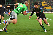 Northampton Saints centre Andy Symons (12) comes in to tackle Harlequins wing Travis Ismaiel (14) during the Gallagher Premiership Rugby match between Northampton Saints and Harlequins at Franklins Gardens, Northampton, United Kingdom on 1 November 2019.