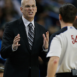 January 17, 2011; New Orleans, LA, USA; Toronto Raptors head coach Jay Triano argues with referee Nick Buchert (54) during a game at the New Orleans Arena. The Hornets defeated the Raptors 85-81.  Mandatory Credit: Derick E. Hingle