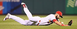 September 27, 2017 - St. Louis, MO, USA - St. Louis Cardinals second baseman Matt Carpenter dives for a single by the Chicago Cubs' Anthony Rizzo to start a five-run seventh inning rally on Wednesday, Sept. 27, 2017, at Busch Stadium in St. Louis. The Cubs clinched the N.L. Central Division title with a 5-1 victory. (Credit Image: © Chris Lee/TNS via ZUMA Wire)