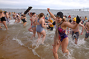Becky Brensinger celebrates as she runs out of the frigid waters of the Chesapeake Bay during the MSP Polar Bear Plunge in support of Special Olympics Maryland at Sandy Point State Park in Annapolis, MD on Saturday, January 29, 2011.