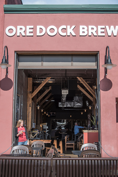 Enjoying a fresh craft beer near the open garage door at the Ore Dock Brewing Company, Marquette, Michigan.