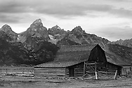 An old abandoned barn sits near the base of the Grand Tetons