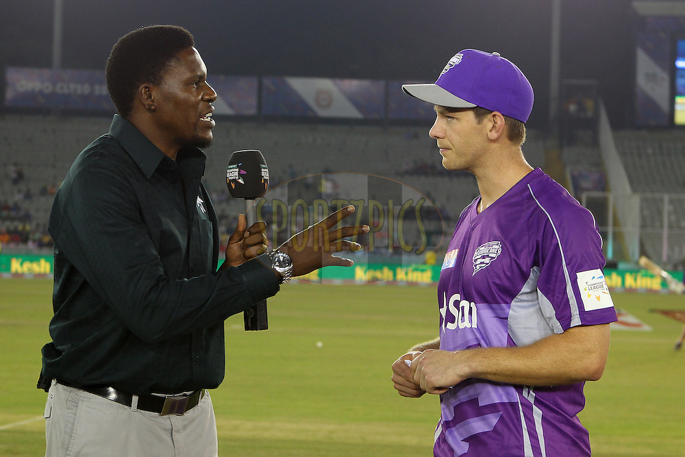 Tim PAINE (Captain) of the Hobart Hurricanes  interviewed before the toss during match 2 of the Oppo Champions League Twenty20 between the Kings XI Punjab and the Hobart Hurricanes held at the Punjab Cricket Association Stadium, Mohali, India on the 18th September 2014<br /> <br /> Photo by:  Ron Gaunt / Sportzpics/ CLT20<br /> <br /> <br /> Image use is subject to the terms and conditions as laid out by the BCCI/ CLT20.  The terms and conditions can be downloaded here:<br /> <br /> http://sportzpics.photoshelter.com/gallery/CLT20-Image-Terms-and-Conditions-2014/G0000IfNJn535VPU/C0000QhhKadWcjYs