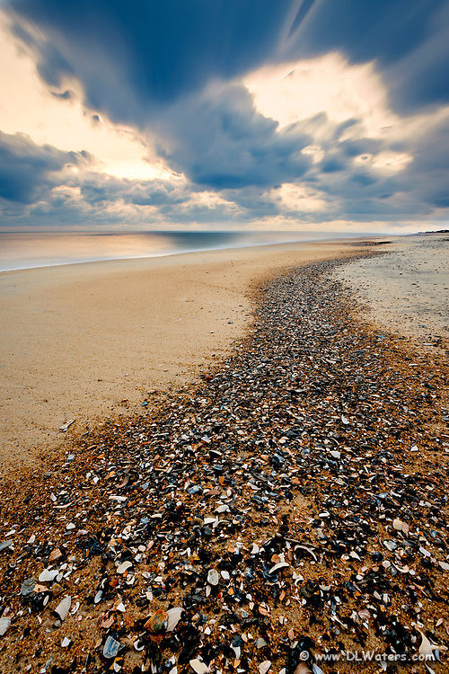 Long exposure of a trail of shell shards washed up on the high tide at Kitty Hawlk Outer Banks beach Christmas morning.