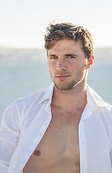 portrait of a handsome man with open shirt