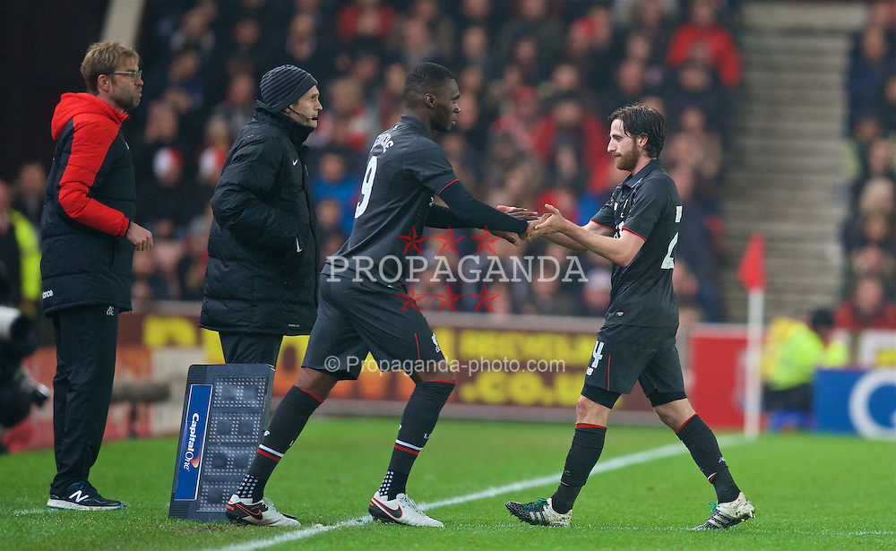STOKE-ON-TRENT, ENGLAND - Tuesday, January 5, 2016: Liverpool's Joe Allen is replaced by substitute Christian Benteke against Stoke City during the Football League Cup Semi-Final 1st Leg match at the Britannia Stadium. (Pic by David Rawcliffe/Propaganda)