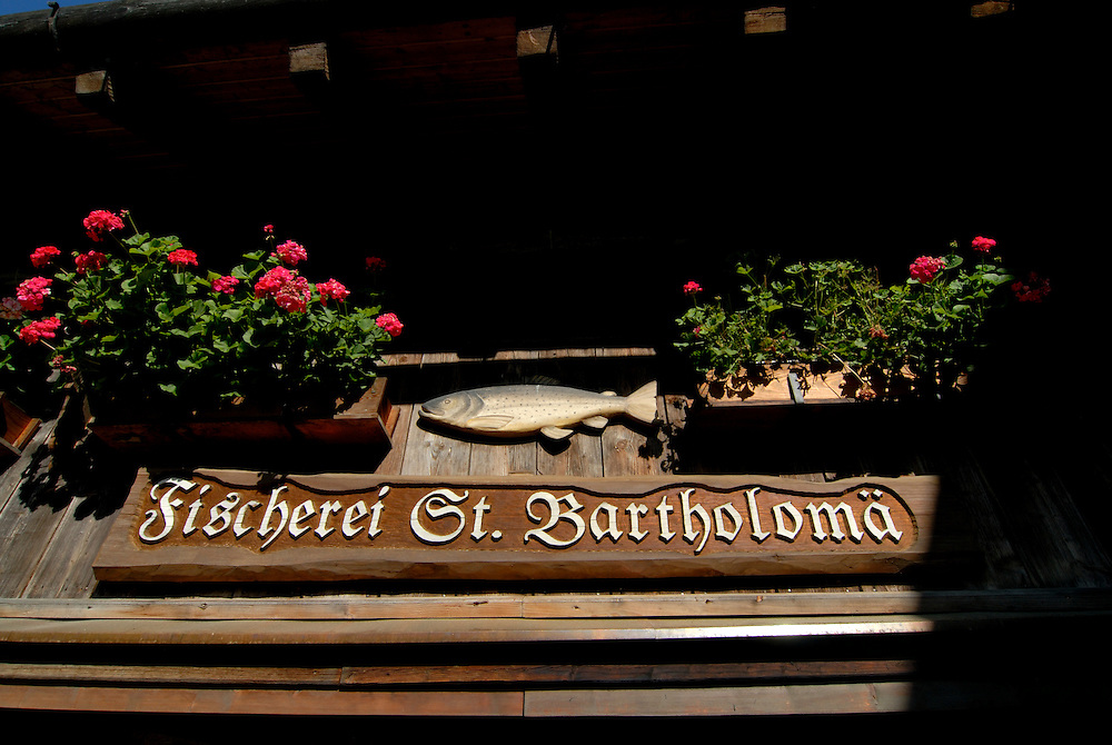 Sign for the very famous St. Bartholomä fish restaurant near St. Bartolomä church on the  Königssee Berchtesgadener land National park, Bavaria, Germany
